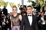 """Professional soccer player Hatem Ben Arfa (R) and guest attends the """"Loving"""" premiere during the 69th annual Cannes Film Festival at the Palais des Festivals on May 16, 2016 in Cannes, France."""