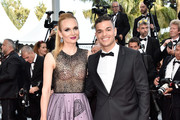 """French soccer player Hatem Ben Arfa and guest attends the """"Loving"""" premiere during the 69th annual Cannes Film Festival at the Palais des Festivals on May 16, 2016 in Cannes, France."""