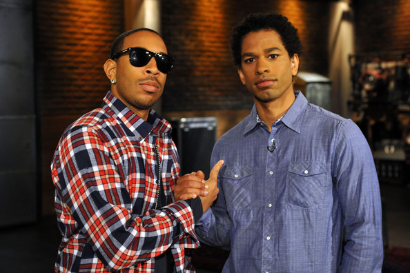 Recording artist and actor Ludacris (L) and host Touré appear on fuse TV at fuse Studios on February 25, 2010 in New York City.