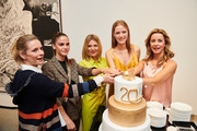 (L-R) Lisa Martinek, Lisa Tomaschewsky, Ella Endlich, Esther Heesch and Bettina Cramer in front of an cake during the 20 years event of Luisa Cerano at Koenig Gallery on July 3, 2018 in Berlin, Germany.