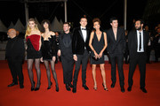 """Abbey Lee, Karl Glusman, Stefania Cristian, Luka Isaac, guests and Félix Maritaud  (R) attends the screening of """"Lux Aeterna"""" during the 72nd annual Cannes Film Festival on May 18, 2019 in Cannes, France."""