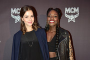 Susan Hoecke wearing 'Milla Clutch' and Choreographer Nikeata Thompson attend the MCM Space Odyssey Event at Frankfurt Opera Store with the 'Diamand Disco' bag on October 22, 2015 in Frankfurt am Main, Germany.
