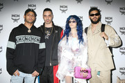 (L-R) Chris Martinez, Marracash, Sita Abellan and Steve Martinez attend the MCM Fashion Show Spring/Summer 2019 during the 94th Pitti Immagine Uomo on June 13, 2018 in Florence, Italy.
