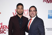 Actor Jussie Smollett (L) and Senior Vice President of Digital Content at Billboard, Mike Bruno attend the Billboard Women in Music Luncheon on December 11, 2015 in New York City.