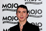 Marc Almond poses with the Mojo Hero Award at the Mojo Hounours List Awards at The Brewery on June 10, 2010 in London, England.