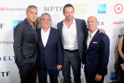 """(L-R)  Host George Clooney, event chair Jim Gianopulos, actors Michael Douglas and DreamWorks Animation CEO Jeffrey Katzenberg attend the MPTF 95th anniversary celebration with """"Hollywood's Night Under The Stars"""" at MPTF Wasserman Campus on October 1, 2016 in Los Angeles, California."""