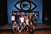 (L-R front) Singer/songwriter Shawn Mendes, rapper Hoodie Allen, singer Beatrice Miller, singer Ryn Weaver, and (L-R behind) guest, musician Etienne Bowler of MisterWives, rapper Jake Miller, musician Dr. Blum of MisterWives, musician Sydney Sierota of Echosmith, musician Marc Campbell of MisterWives, guest, musician Mandy Lee of MisterWives, singer Jacquie Lee, and musician William Hehir of MisterWives pose onstage during the MTV Artists to Watch at House of Blues Sunset Strip on February 5, 2015 in West Hollywood, California.
