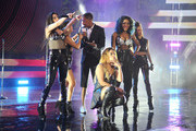 Fifth Harmony and Nick Cannon perform on stage during the 2014 MTV EMA Kick Off at the Klipsch Amphitheater on November 9, 2014 in Miami, Florida.