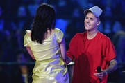 Charli XCX greets Justin Bieber accepting the award for Best Collaboration from on stage during the MTV EMA's 2015 at the Mediolanum Forum on October 25, 2015 in Milan, Italy.