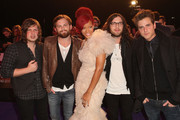 L-R (L-R) Musicians Matthew Followill, Caleb Followill, Rihanna, Nathan Followill and Jared Followill  of Kings Of Leon attend the MTV Europe Awards 2010 at the La Caja Magica on November 7, 2010 in Madrid, Spain.