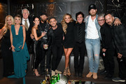 (L-R) Allison Jones, Danielle Bradbery, George Briner, Amber Cochran Gilbert, Brantley Gilbert, Michael Ray, Carly Pearce, Scott Borchetta, Brian Kelley of Florida Georgia Line, Jimmy Harnen, and Matthew Hargis are seen as Big Machine Label Group Celebrates the 54th Annual ACM Awards at Hakkasan Las Vegas Restaurant and Nightclub on April 07, 2019 in Las Vegas, Nevada.