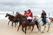 Billy SLater and Nacho Figueras ride on the beach after the 2019 Magic Millions official draw at Surfers Paradise Foreshore on January 08, 2019 in Gold Coast, Australia.