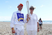 Jockey Hugh Bowman and Zara Phillips pose with The Commonwealth Games Queen's Baton on Surfers Paradise beach during the Magic Millions Barrier Draw on January 9, 2018 in Gold Coast, Australia.
