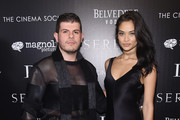 "Eli Mizrahi and model Shanina Shaik attend a screening of ""Serena"" hosted by Magnolia Pictures and The Cinema Society with Dior Beauty on March 21, 2015 in New York City."