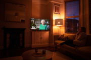 The photographer's partner watches as Queen Elizabeth II addresses the nation in a special broadcast to the United Kingdom and the Commonwealth in relation to the Coronavirus outbreak on April 05, 2020 in London, England. The Coronavirus (COVID-19) pandemic has spread to many countries across the world, claiming over 50,000 lives and infecting over 1 million people.