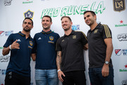 Sebastian Lletget and Chris Pontius of the LA Galaxy and Jordan Harvey and Steven Beitashour of the LAFC pose for photos upon arriving at the MLS Heineken Rivalry Week Secret Walls event held at START Los Angeles on August 22, 2018 in Los Angeles, California.