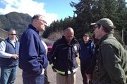 In this handout from the Office of the Governor of Washington Jay Inslee, Washington Governor Jay Inslee (L) speaks with Mayor of Darrington Dan Rankin (R) while surveying damage caused by a massive mudslide on March 23, 2014 between Darrington and Arlington, Washington. Eight people have been confirmed dead and over 100 are still missing after a massive mudslide leveled homes and blocked a river and a road.