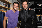(L-R) Tony Dovolani and Maksim Chmerkovskiy attend the launch of Cantamessa Man with Maksim Chmerkovskiy at the Closet by Sharon Segal and Nina Segal at The Promenade at Westlake on October 8, 2015 in Westlake Village, California.