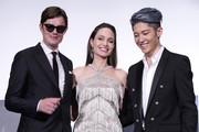 (L-R) Sam Riley, Angelina Jolie, and MIYAVI greet on stage during the Japan premiere of 'Maleficent: Mistress of Evil' on October 03, 2019 in Tokyo, Japan.