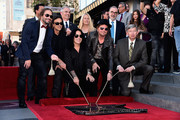 Musicians Sergio Vallin, Juan Calleros, ALex Gonzalez, Fher Olvera and Hollywood Chamber of Commerce President & CEO Leron Gubler attend a ceremony honoring Maná with the 2,573rd Star on the Hollywood Walk of Fame on February 10, 2016 in Hollywood, California.