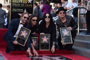 Musicians Fher Olvera, Alex Gonzalez, Sergio Vallin and Juan Calleros of the Mexican rock band Maná attend a ceremony honoring them with the 2,573rd Star on the Hollywood Walk of Fame on February 10, 2016 in Hollywood, California.
