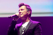 Rick Astley performs during the 'We Are Manchester' benefit concert at Manchester Arena on September 9, 2017 in Manchester, England. Manchester Arena officially reopens following the terror attack on May 22nd. The concert will support the Manchester Memorial Fund.
