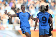 Jill Scott (L) of Manchester City Women celebrates with her team-mate Toni Duggan after winning the Continental Cup Final between Manchester City Women and Birmingham City Ladies at The Academy Stadium on October 2, 2016 in Manchester, England.