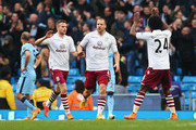 Tom Cleverley (L) of Aston Villa celebrates his goal with Ron Vlaar and Carlos Sanchez of Aston Villa during the Barclays Premier League match between Manchester City and Aston Villa at Etihad Stadium on April 25, 2015 in Manchester, England.