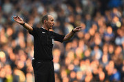 Referee Mike Deanin action during the Barclays Premier League match between Manchester City and Chelsea at Etihad Stadium on September 21, 2014 in Manchester, England.