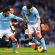 Carlos Tevez Gareth Barry Photos