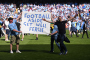 Manchester City fans send a get well message to Sir Alex Ferguson during the Premier League match between Manchester City and Huddersfield Town at Etihad Stadium on May 6, 2018 in Manchester, England.