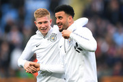 Kevin De Bruyne of Manchester City talks with Kyle Walker of Manchester City prior to the Premier League match between Manchester City and Manchester United at Etihad Stadium on April 7, 2018 in Manchester, England.