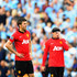 Wayne Rooney (R) and Michael Carrick of Manchester United look dejected during the Barclays Premier League match between Manchester City and Manchester United at the Etihad Stadium on September 22, 2013 in Manchester, England.