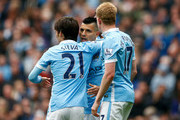 Sergio Aguero (C) of Manchester City celebrates scoring his team's third and hat trick goal with his team mates David Silva (L) and Kevin de Bruyne (R) during the Barclays Premier League match between Manchester City and Newcastle United at Etihad Stadium on October 3, 2015 in Manchester, United Kingdom.
