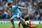 David Silva of Manchester City and Filip Djuricic of Southampton compete for the ball during the Barclays Premier League match between Manchester City and Southampton at Etihad Stadium on May 24, 2015 in Manchester, England.