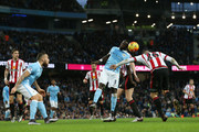 Bacary Sagna of Manchester City and Steven Fletcher of Sunderland battle for a header during the Barclays Premier League match between Manchester City and Sunderland at the Etihad Stadium on December 26, 2015 in Manchester, England.