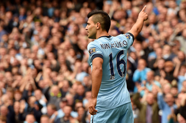 Sergio Aguero of Manchester City celebrates after scoring the opening goal during the Barclays Premier League match between Manchester City and Tottenham Hotspur at Etihad Stadium on October 18, 2014 in Manchester, England.