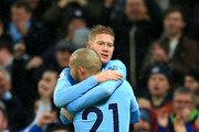 Kevin De Bruyne of Manchester City celebrates his sides second goal with David Silva of Manchester City during the Premier League match between Manchester City and Watford at Etihad Stadium on January 2, 2018 in Manchester, England.