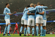 Players of Manchester City celebrate during the Premier League match between Manchester City and Watford at Etihad Stadium on January 2, 2018 in Manchester, England.
