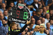 Fourth official Mike Jones holds the electronic board as Samir Nasri of Manchester City comes on as a substitute during the Premier League match between Manchester City and West Ham United at Etihad Stadium on August 28, 2016 in Manchester, England.