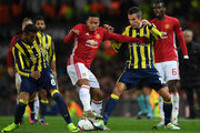 Anthony Martial of Manchester United is challenged by Souza (L) and Robin van Persie (R) of Fenerbahce during the UEFA Europa League Group A match between Manchester United FC and Fenerbahce SK at Old Trafford on October 20, 2016 in Manchester, England.