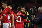 Wayne Rooney of Manchester United hugs Robin van Persie of Fenerbahce following the final whistle during the UEFA Europa League Group A match between Manchester United FC and Fenerbahce SK at Old Trafford on October 20, 2016 in Manchester, England.
