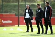 Jose Mourinho, Manager of Manchester United looks on with his backroom staff during a training session ahead of their UEFA Champions League Group H match against Juventus at Aon Training Complex on October 22, 2018 in Manchester, England.