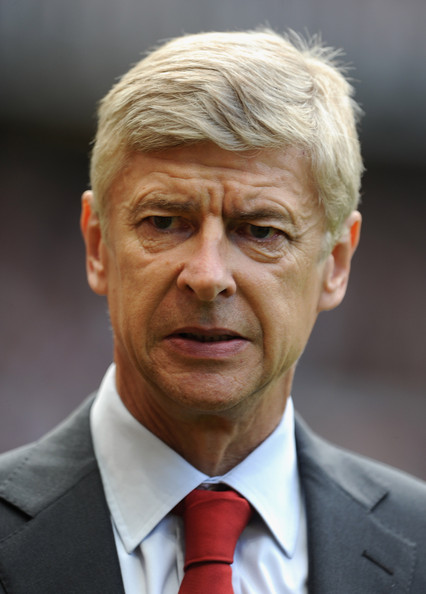 Manager arsene wenger looks on prior to the barclays premier league