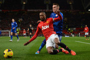 Patrice Evra of Manchester United tangles with Craig Noone of Cardiff City during the Barclays Premier League match between Manchester United and Cardiff City at Old Trafford on January 28, 2014 in Manchester, England.