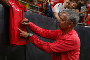 Manchester United manager Jose Mourinho signs an autograph prior to the International Champions Cup game against Club America at the University of Phoenix Stadium on July 19, 2018 in Glendale, Arizona.