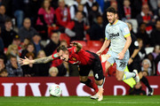 Phil Jones of Manchester United is challenged by David Nugent of Derby County during the Carabao Cup Third Round match between Manchester United and Derby County at Old Trafford on September 25, 2018 in Manchester, England.