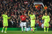 Luis Suarez of Barcelona celebrates his sides first goal, an own goal by Manchester United's Luke Shaw, during the UEFA Champions League Quarter Final first leg match between Manchester United and FC Barcelona at Old Trafford on April 10, 2019 in Manchester, England.