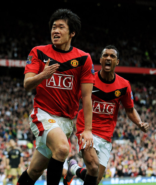 Ji-Sung Park of Manchester United celebrates scoring the winning goal with team mate Nani during the Barclays Premier League match between Manchester United and Liverpool at Old Trafford on March 21, 2010 in Manchester, England.