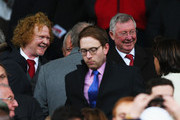 Sir Alex Ferguson and musician Mick Hucknall look on prior to the Barclays Premier League match between Manchester United and Manchester City at Old Trafford on April 12, 2015 in Manchester, England.
